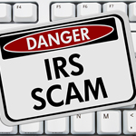 sign saying Danger IRS scam